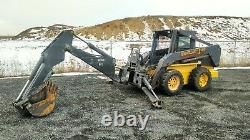 2002 New Holland LS180 Skid Steer. Bobcat with BackHoe Attachment